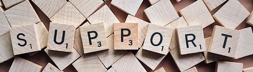 wooden blocks spelling SUPPORT